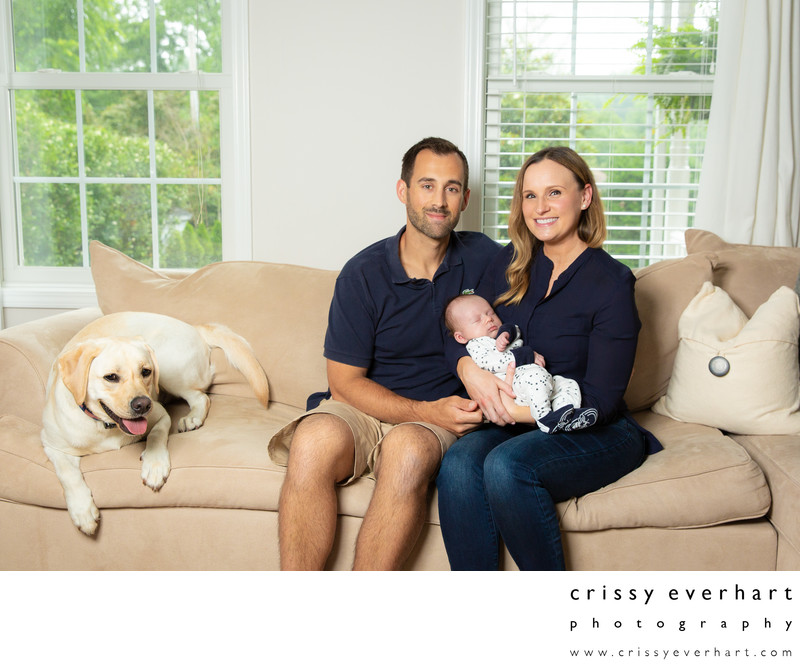 Newborn Photos with Parents and Dog on Sofa
