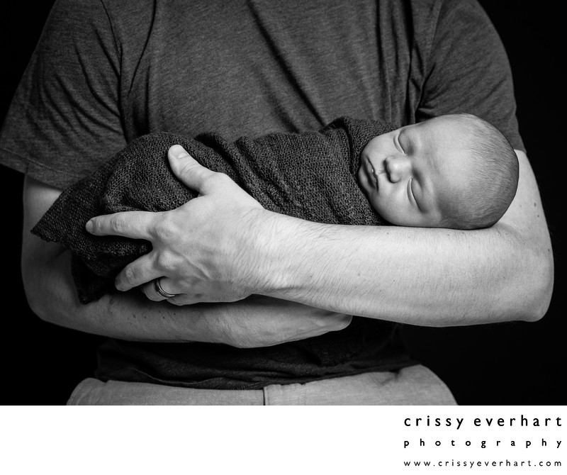 Newborn Baby Swaddled in Dad's Arms