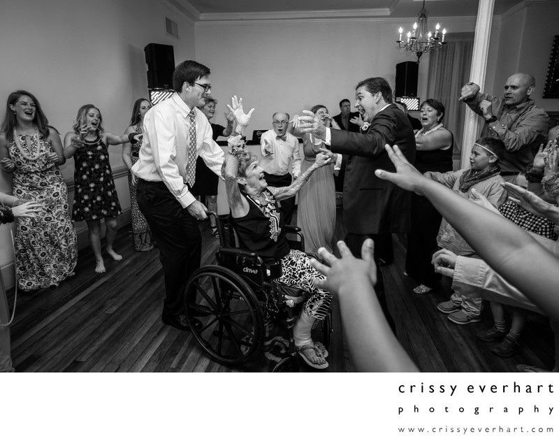 Groom and Wheelchair-Bound Mom Dance at Wedding