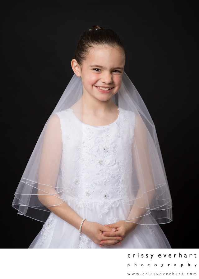 First Holy Communion Photos on Black Backdrop