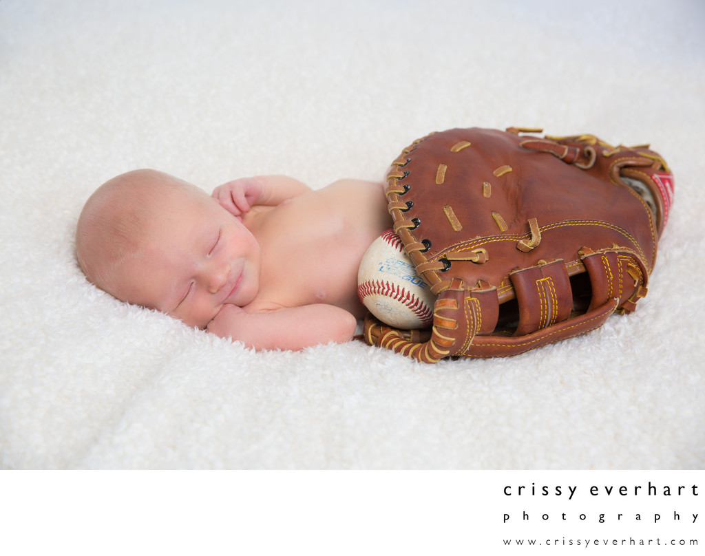 Newborn Photographer - Baby in Dad's Baseball Mitt