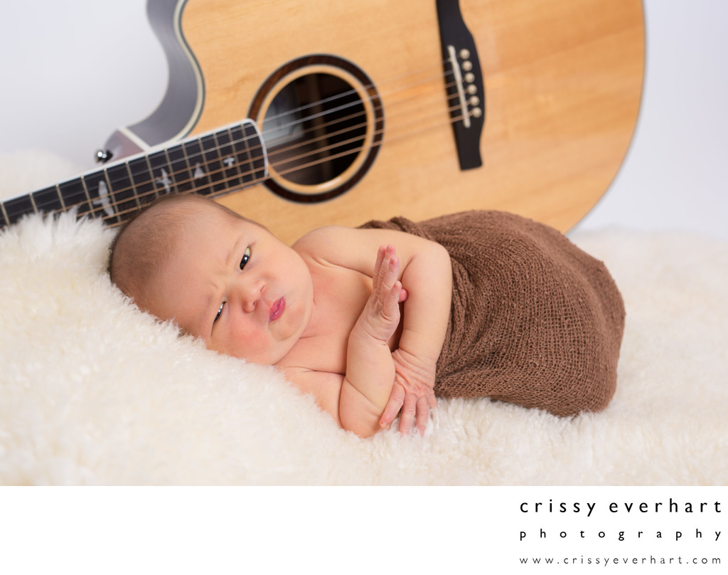 Newborn Photography - Baby in Front of Dad's Guitar