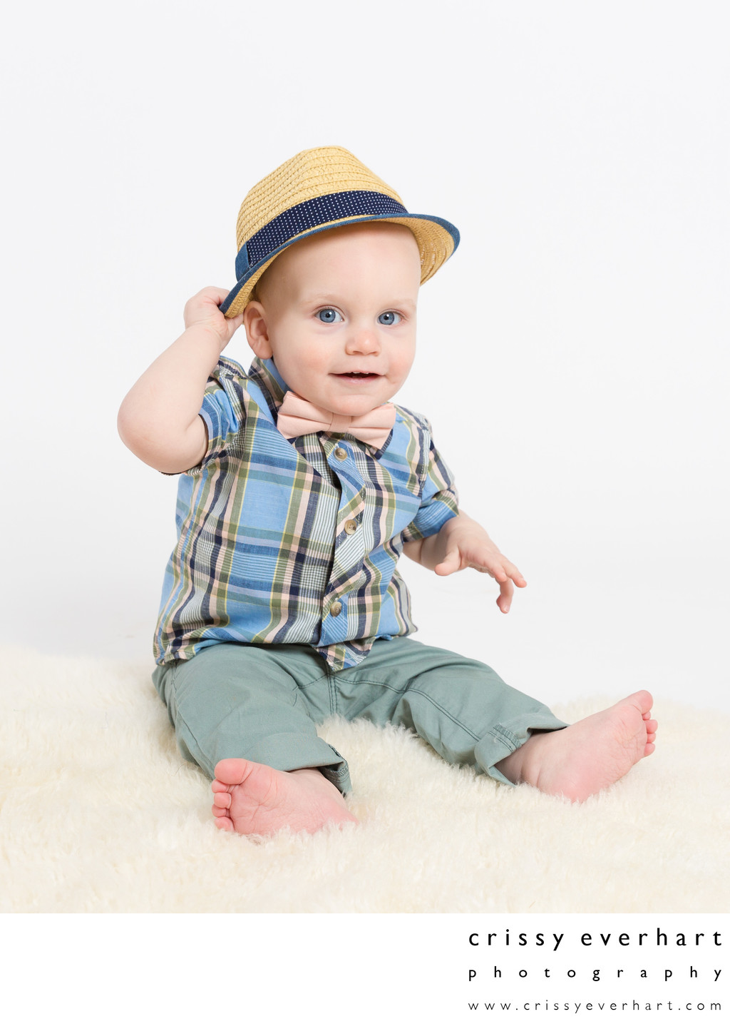 Stylish One Year Old with Hat and Bow Tie