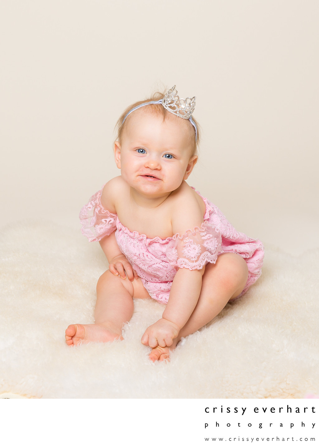 One Year Old Girl with Crown on Ivory Background