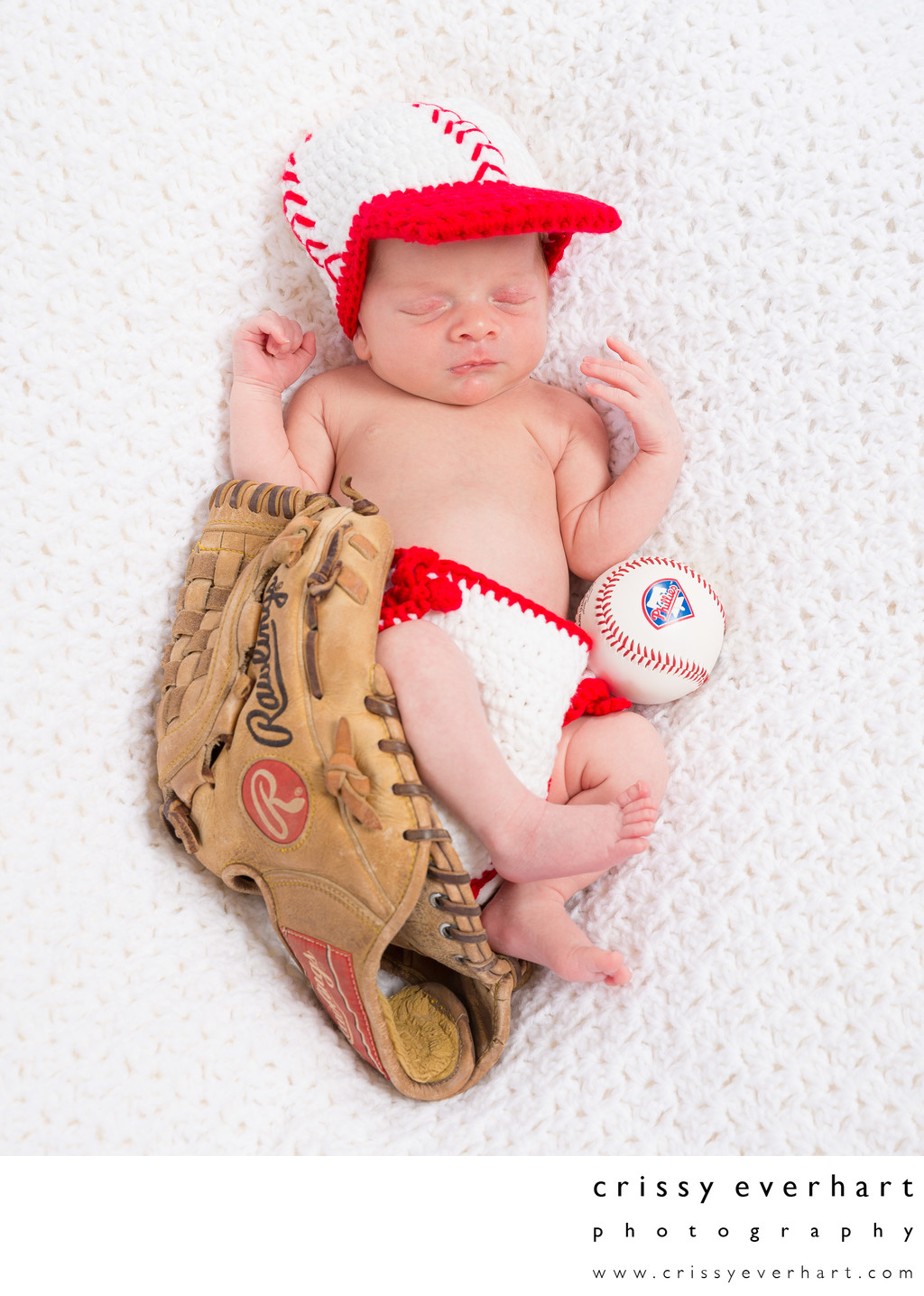 Baby in Knit Phillies Outfit with Baseball and Glove