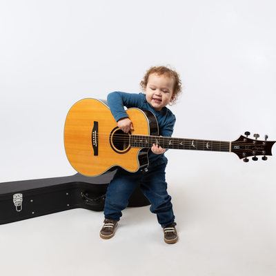 Studio Portraits of Active Toddlers - Boy with Guitar