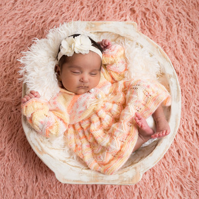 Infant Girl Asleep in Wooden Bowl, Pink