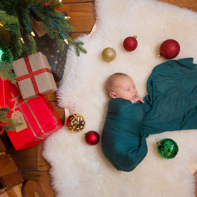 Holiday Newborn Photos - Baby Under Christmas Tree