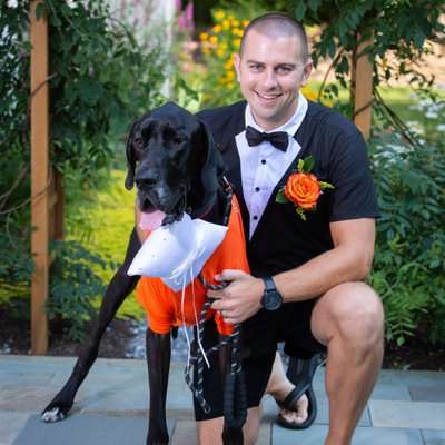 Groom in Tuxedo Onesie with Dog Ring Bearer