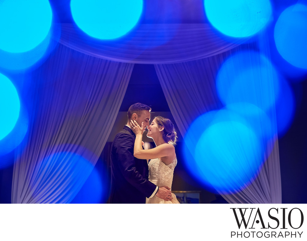 Evening portrait of couple kissing during reception