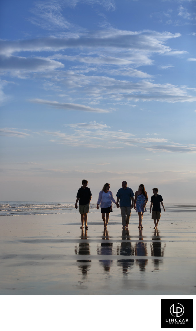 family stroll on beach photo
