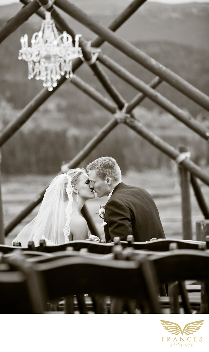 Kissing couple Devils Thumb Ranch wedding photography