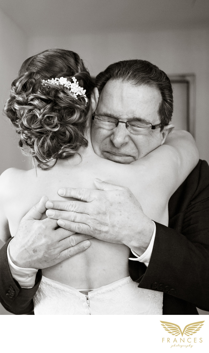 Father hugs bride Denver wedding photographer
