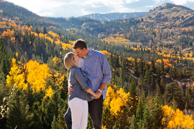 Fall mountain kiss Colorado engagement photography