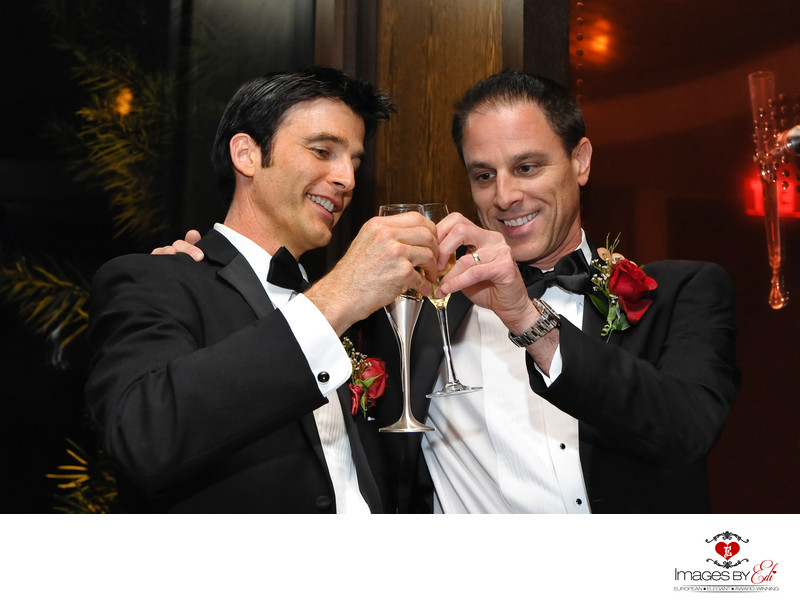 Groom and best man champagne toast at Wynn Las Vegas Hotel reception