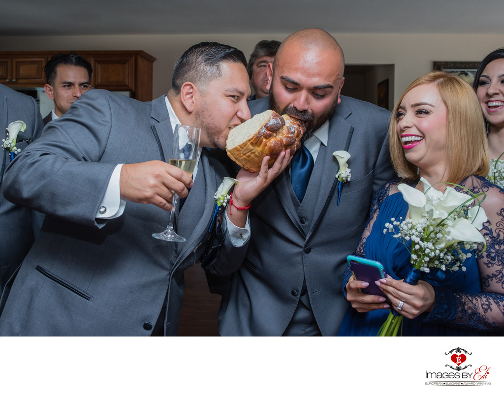 Romanian orthodox wedding traditions, braking and catching of the traditional bridal cake (sweet bread).