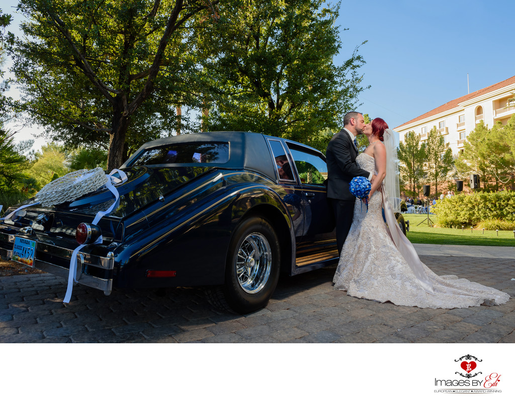JW Marriott Las Vegas wedding Photo of the couple in front of an old car