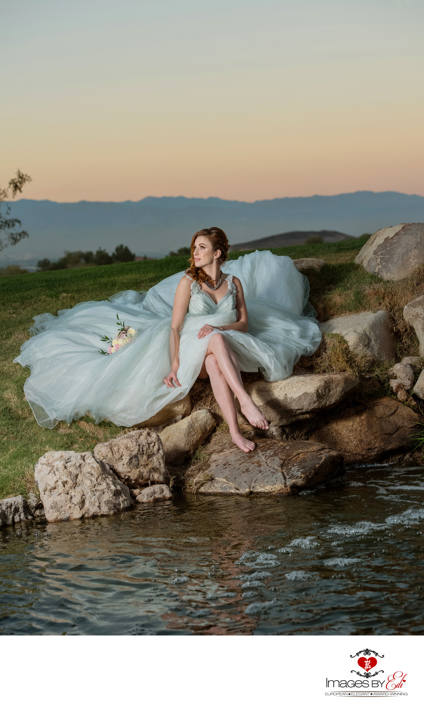 Anthem Country Club Las Vegas Wedding Photographer | Wedding Photo of Bride Sitting by the Lake | Spectacular Bride Magazine Wedding Photo | Images by EDI