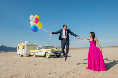 Dry Lake Bed Engagement Session with old car and balloons