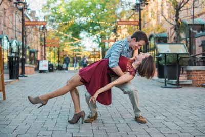 Engaged Couple Dancing at Brightleaf Square in Durham