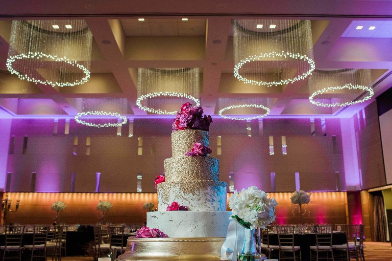 The Four Seasons wedding cake St Louis photographer