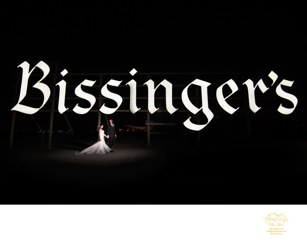 Bissingers rooftop bride and groom night image