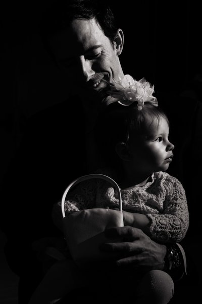 Black and white moody image of flower girl