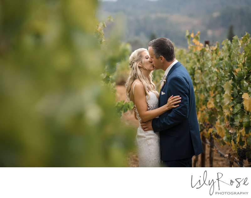 Wedding Couple in Vineyard at Ledson Winery