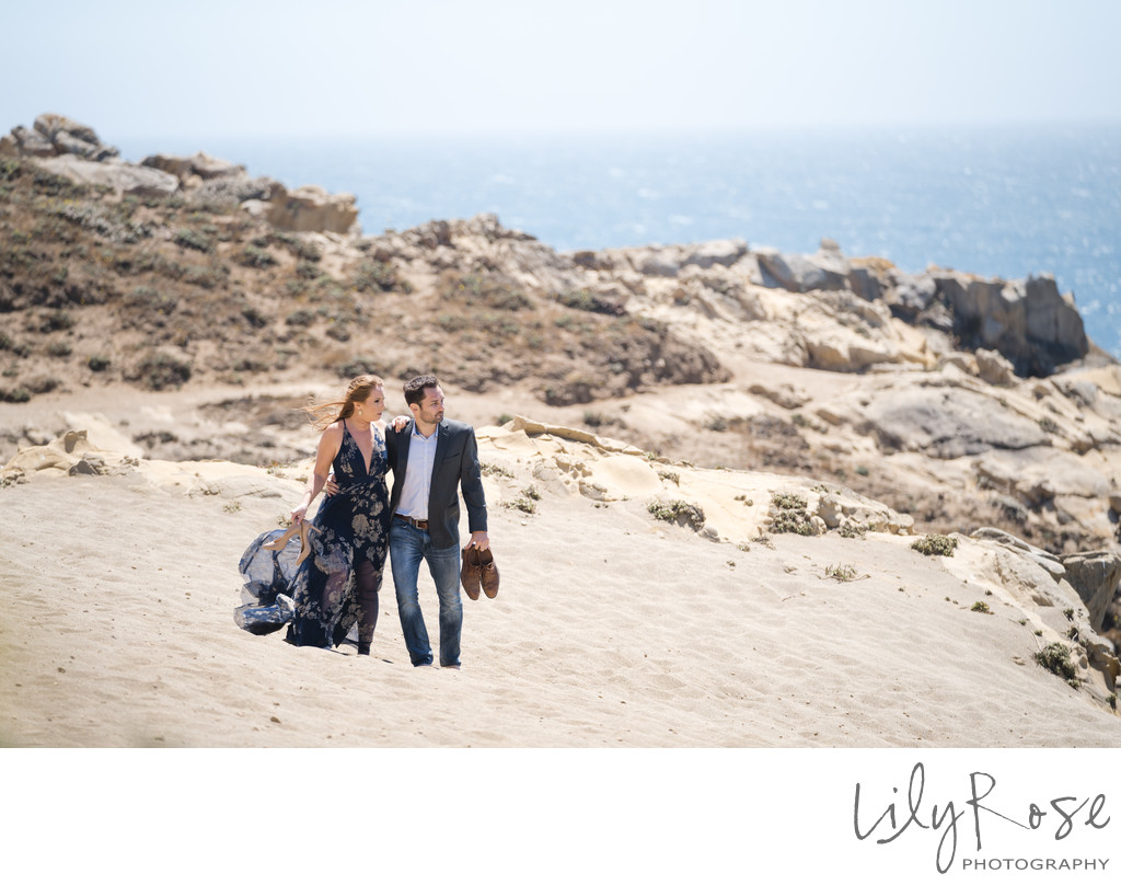 Engaged Couple along the Beach at Timber Cove Resort