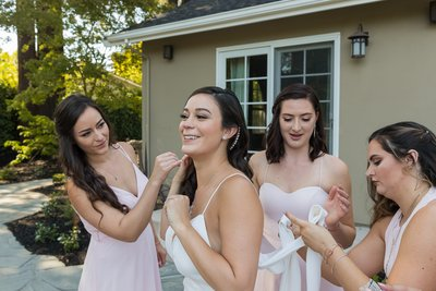 The girls getting the bride ready | Zoart Photography