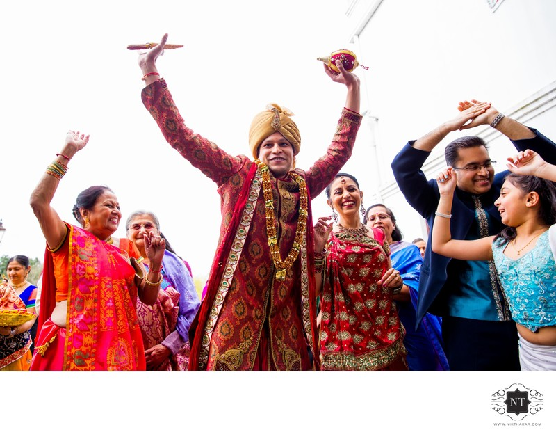 Groom dancing in baarat