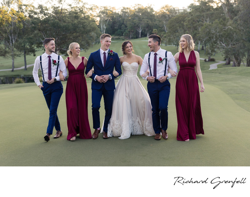 Bridal Party walking on a green at a Golf Club