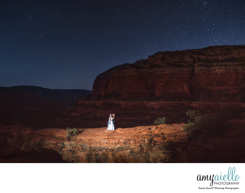 bride and groom at night on devils bridge in sedona arizona wedding photographer chicago photographer
