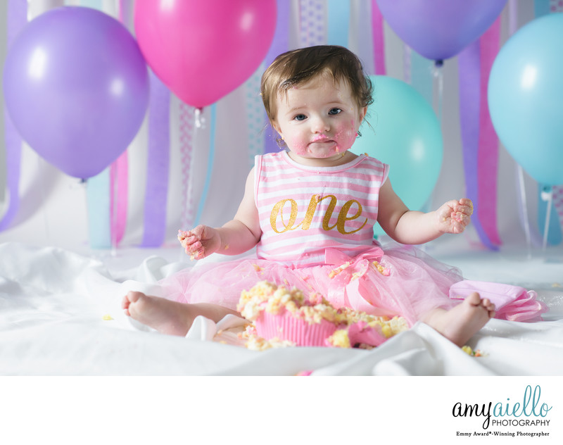 one year old first birthday photo session chicago children's photographer chicago suburbs children's photographer cake smash balloons twins boy girl