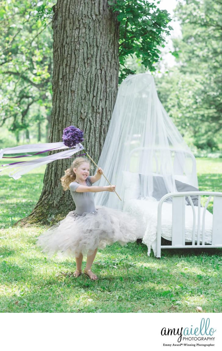 chicago childrens photographer whimsical little girls tulle skirts flower wands outdoor bed and canopy