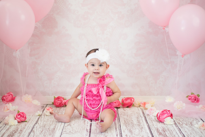 Baby Girl First Birthday with Balloons and Flowers