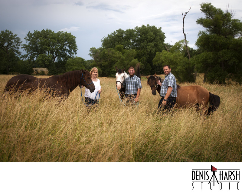 Peoria Photographers - A Family with Horses in Tall Grass