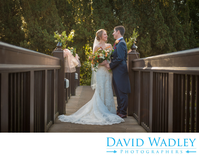 Bride & Groom photographed on the bridge at New Hall Hotel in Sutton Coldfield.