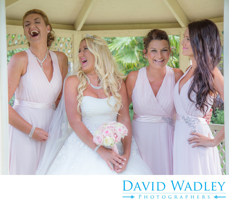 Bridal party laughing at Warwick House