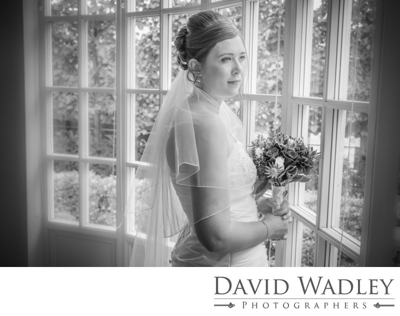 Bride looking out at Warwick House