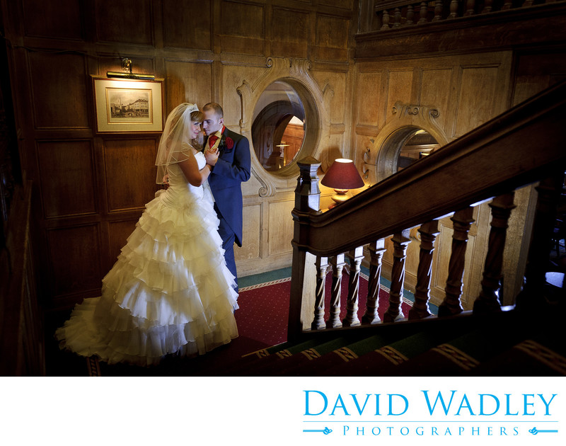 Bride & Groom photographed on staircase at Moor Hall Hotel.