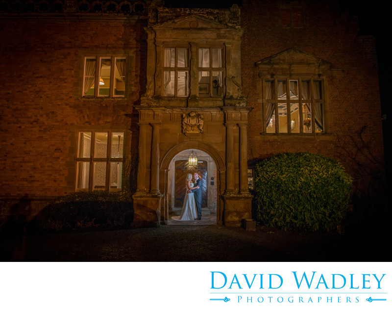 Nighttime wedding kiss for the happy couple at Grafton Manor Hotel.