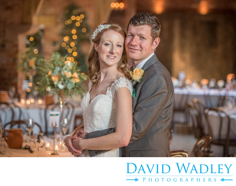 Bride & Groom on their wedding day photographed inside stunning Shustoke Barns.