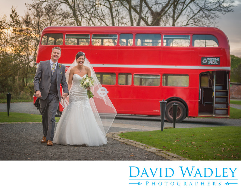 Bride & Groom photographed with London bus outside stunning Shustoke Barn.