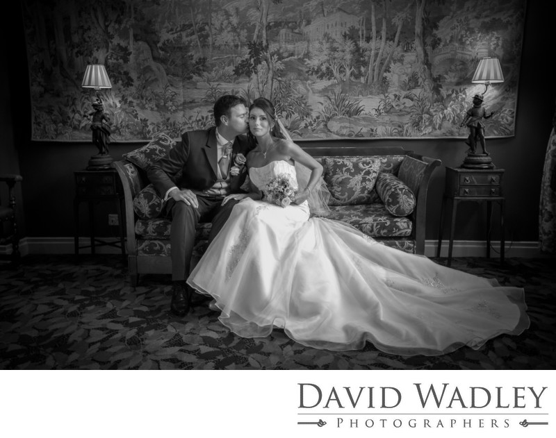 Bride & Groom sitting together on their wedding in New Hall Hotel.