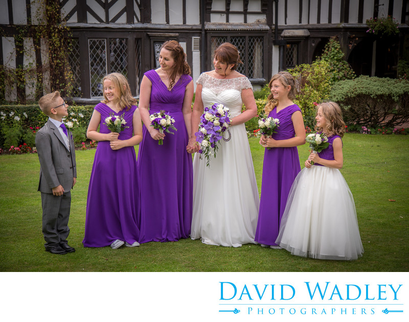 Bride & bridesmaids talking to pageboy at Nailcote Hall