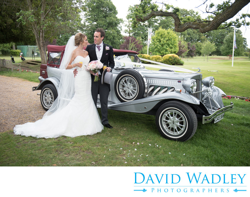 Silver wedding car at Nailcote Hall.