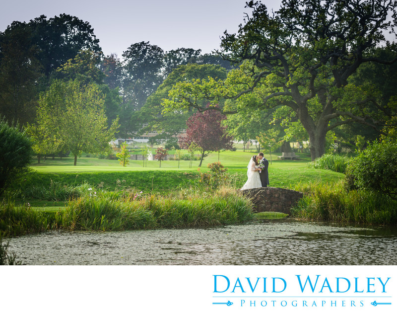 Wedding couple on the bridge at Nailcote Hall