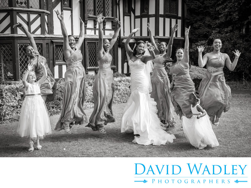 Bride & Bridesmaid jumping together at Nailcote Hall.