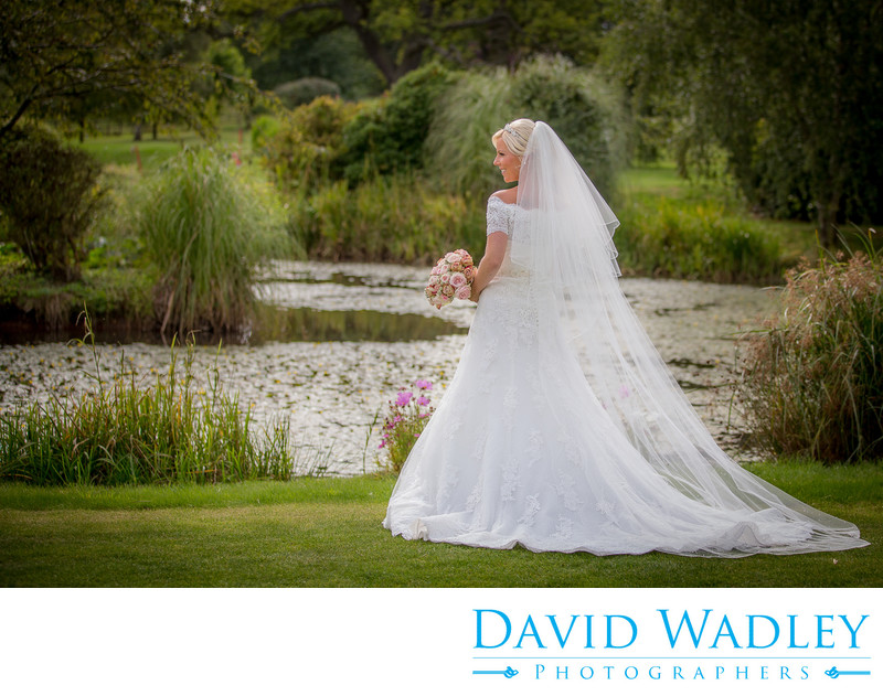 The bride in the lovely gardens of Nailcote Hall.